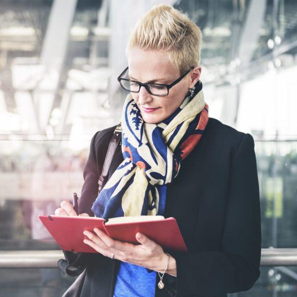 businesswoman writing waiting flight concept PA72YZ6
