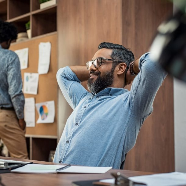 mature business man relaxing at work 89RAFWT